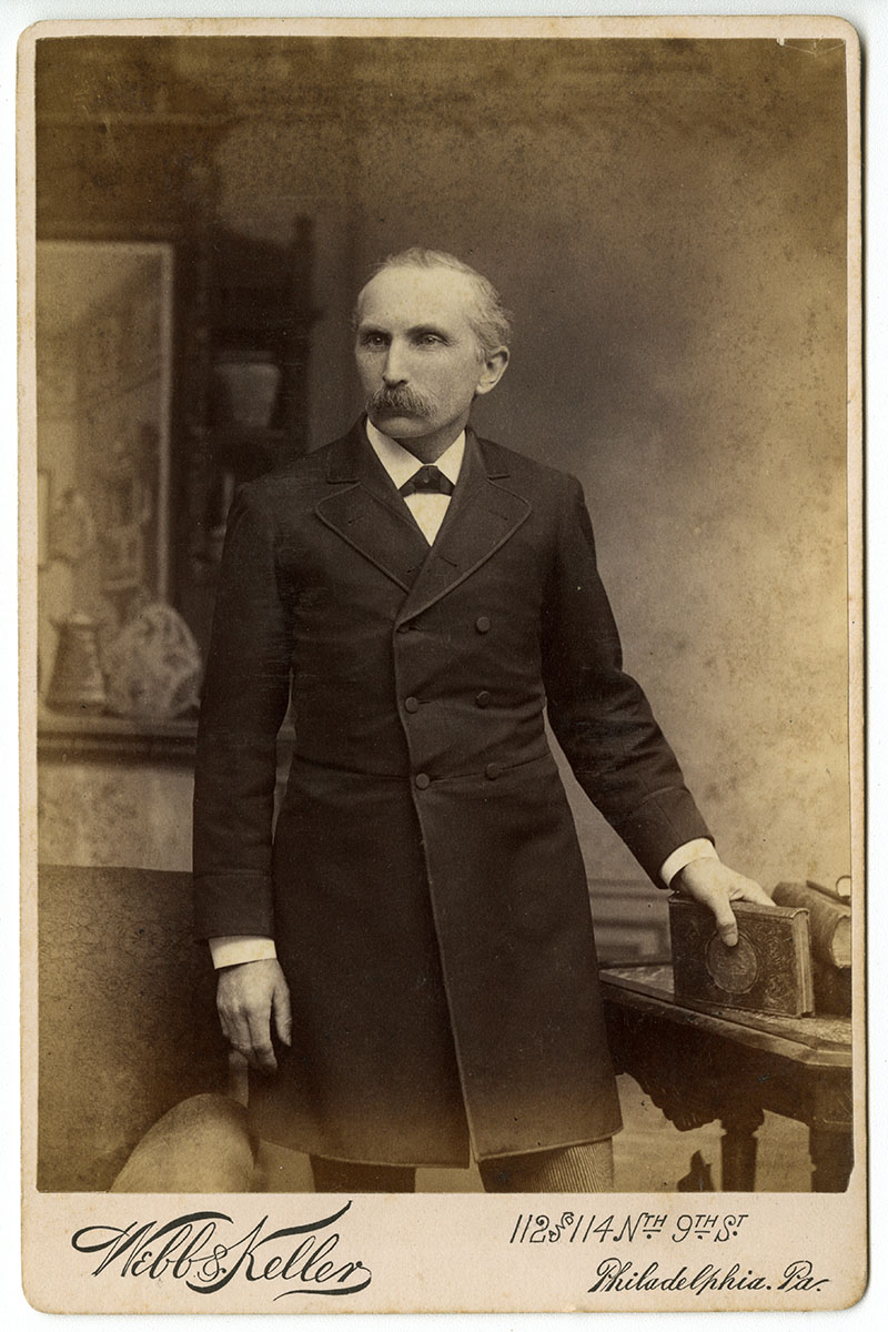Unidentified man posing with book (Philadelphia, late 19th century). Cabinet card photograph.