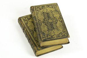 The Holy Bible (Edinburgh, 1758). This two volume set of the Bible is hand-stamped with an elaborate pattern that was typical of refined Scottish bindings in the 18th century.