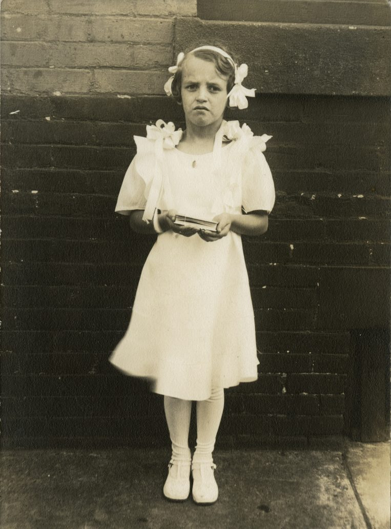 John Frank Keith. Girl in First Communion Dress (Philadelphia, ca. 1931). Gelatin silver photograph.