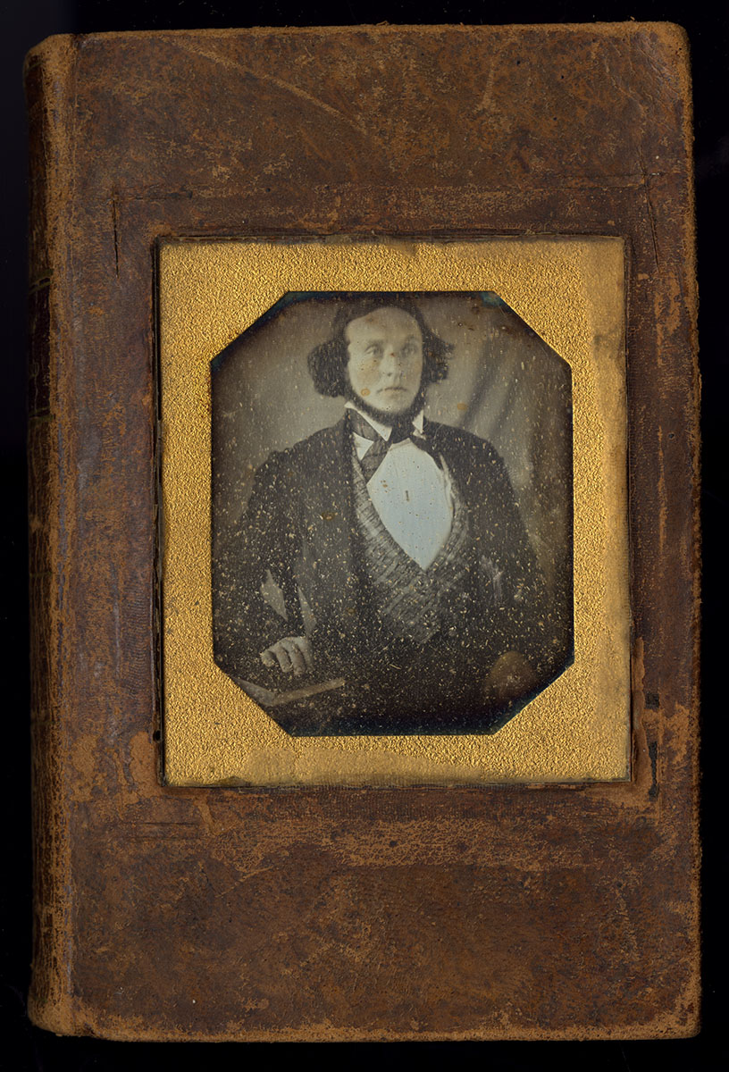 Jonathan Edwards, The Life of Rev. David Brainerd (New York, 1834). Michael Zinman Binding Collection. Someone customized this book by insetting a glass daguerreotype plate. We built a custom-fitted box to protect the delicate cover. Watch a box being constructed on the video screen.